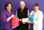 Swiss American Products and Elta MD provided the 2014 and 2015 WHF Warrior Care Kits. Swiss-American Project Coordinator Tina Jackson and Swiss-American President Phil O'Neill accept the Generosity in Giving plaque from WHF President Laura K. S. Parnell. Photo courtesy of Carol Bocell.