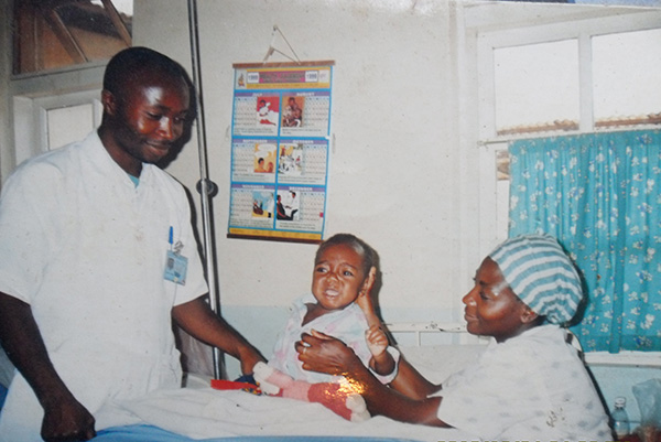 Clinical grant recipient Joshua Ngwang Menang with grateful patients in Cameroon, Africa